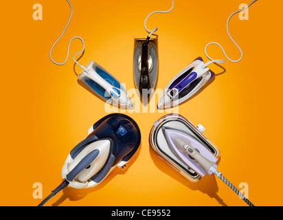 Five irons on a yellow background - Stock Image