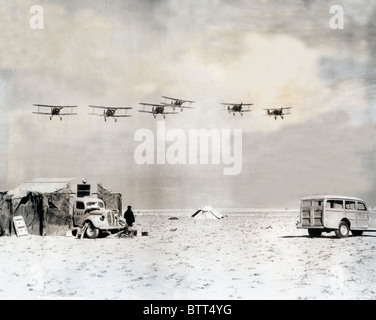 An Australian Gladiator Fighter Patrol flying in to its desert base after keeping the skies clear for the final - Stock Image