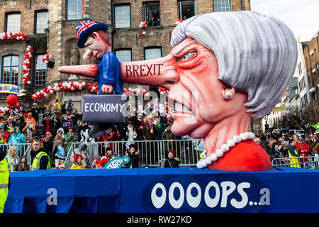 Düsseldorf, Germany. 4th March 2019. The annual Rosenmontag (Rose Monday or Shrove Monday) carnival parade takes place in Düsseldorf. Carnival float designed by Jacques Tilly depicting Theresa May as Pinocchio damaging the economy due to Brexit. Photo: Vibrant Pictures/Alamy Live News - Stock Image
