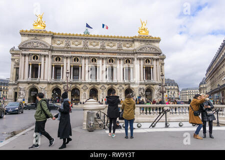 Tourists taking photos in front of the Paris Opera Garnier, France. - Stock Image