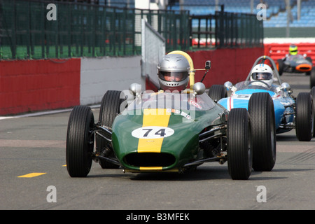 green racing car crossing the starting line Silverstone - Stock Image