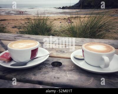 Coffee by the beach. - Stock Image