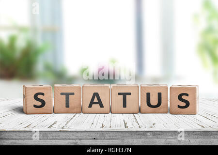 Status sign made of wood on a table in a bright room - Stock Image