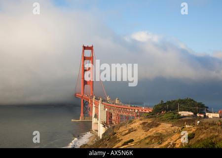 Fog rolling through the Golden Gate Bridge San Francisco California - Stock Image