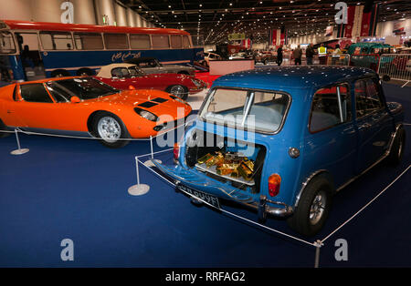 Special display of vehicles which  featured in iconic British film 'The Italian Job' on display at the 2019 London Classic Car Show - Stock Image