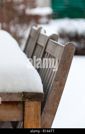 Snow on a garden table in winter - Stock Image