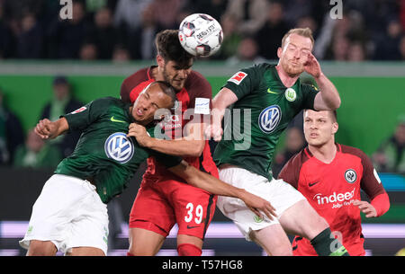 Wolfsburg, Germany. 22nd Apr, 2019. Soccer: Bundesliga, 30th matchday: VfL Wolfsburg - Eintracht Frankfurt in the Volkswagen Arena. Wolfsburg's Marcel Tisserand (l) and Maximilian Arnold (r) and Frankfurt's Goncalo Paciencia fight for the ball. Credit: Peter Steffen/dpa - IMPORTANT NOTE: In accordance with the requirements of the DFL Deutsche Fußball Liga or the DFB Deutscher Fußball-Bund, it is prohibited to use or have used photographs taken in the stadium and/or the match in the form of sequence images and/or video-like photo sequences./dpa/Alamy Live News - Stock Image