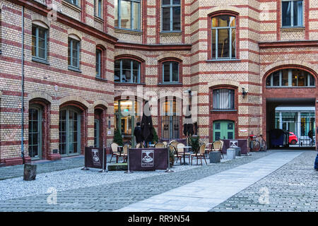 Einstein Kaffee - Coffee shop with outdoor tables and chairs in Inner courtyard in Mitte,berlin - Stock Image