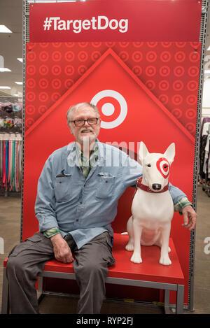 Man posing with Target Dog in Target store. - Stock Image