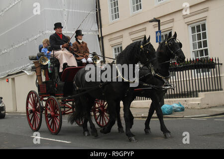 London, UK. 25th Dec, 2018: A horse drawn carriage seen around Claridge's Hotel on Christmas day, when the cit was virtually empty with no public transport running on. Some parts of the city experienced dense fog which is expected to linger for the rest of the week. Credit: David Mbiyu/Alamy Live News - Stock Image