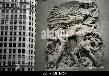 Chicago, USA. Sculpture by James Earl Fraser on Chicago River bridge at Michigan Avenue. Native Indians attack Fort - Stock Image