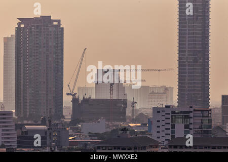 High rise tower buildings under construction in Bangkok, Thailand - Stock Image