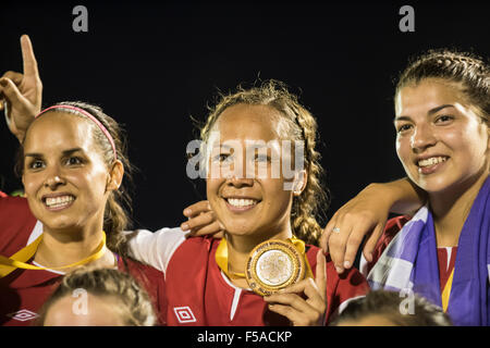 Palmas, Brazil. 30th October, 2015. The USA indigenous women's team celebrate after winning the final against - Stock Image