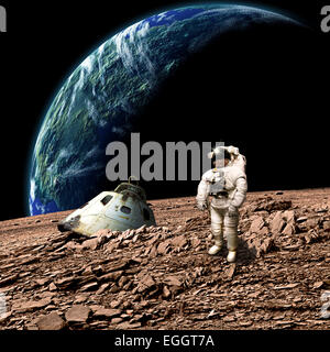 An astronaut surveys his situation after being marooned on a barren planet. An Earth-like planet shines in the background. - Stock Image