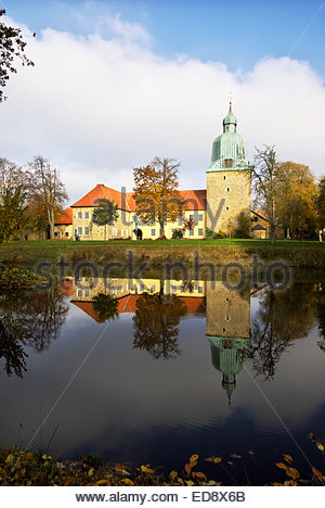 Fürstenau castle reflects in the moat that surrounds it. - Stock Image