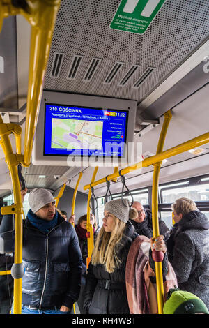 Electronic destination board and passengers on a city bus from the airport, Gdańsk, Poland - Stock Image