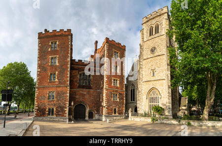 London, England, UK - May 28, 2019: Evening sun shines on the Garden Museum church and Morton's Tower at Lambeth Palace. - Stock Image