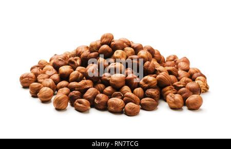 Handful of hazelnut nuts isolated on white background - Stock Image