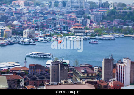Red balloon flying over Istanbul. Sights of the city of Istanbul architecture and boat trips on ships - Stock Image