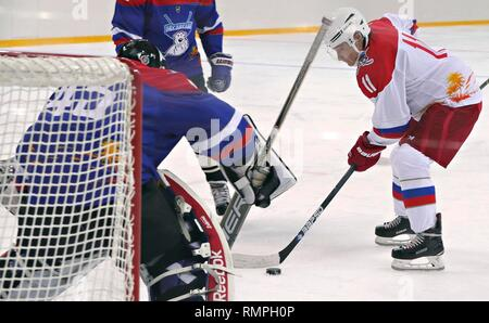 Sochi, Russia. 15th Feb, 2019. Russian President Vladimir Putin, #11, right, takes a shot on goal during a friendly ice hockey match with Belarus President Alexander Lukashenko at the Shaiba Arena February 15, 2019 in Sochi, Russia. Credit: Planetpix/Alamy Live News - Stock Image