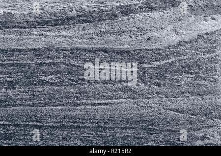 Migmatitic gneiss migmatite rock bands pattern, grey light dark banded granite texture macro closeup, large detailed textured silver gray horizontal - Stock Image