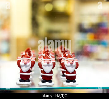 Father Christmas, or Santa Claus, icing sugar cake decorations - Stock Image