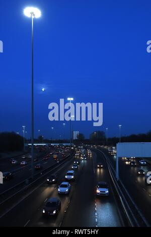 The M8 traffic at Kinning Park, Glasgow, Scotland on a cold cloudless morning at daybreak on the daily commute to work in the UK. - Stock Image