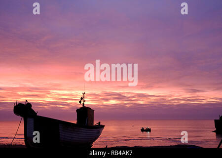 Hastings, East Sussex, UK. 7th Jan 2019. Very mild start to the day at sunrise on the Stade Fishermen's beach as fishermen start loading their boats. Hastings has the largest beach launched fishing fleets in Britain. - Stock Image