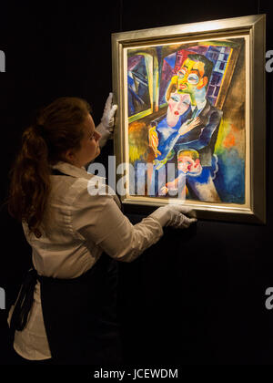 London, UK. 15 June 2017. A Sotheby's technician hangs the painting Selbstbildnis mit meiner Frau London und - Stock Image