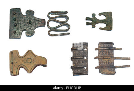 Huelva, Spain - July 02, 2018: Bronze tartessian brooches at Archaeological Museum of Huelva, Andalusia, Spain - Stock Image