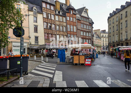 Market stalls being set up on the day of sales at Rennes the capital of Brittany, France - Stock Image