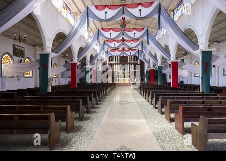Interior of old Catholic Church with Prayer Booths, Religious Symbols and No People. San Juan village, Lake Atitlan Guatemala Highlandss - Stock Image