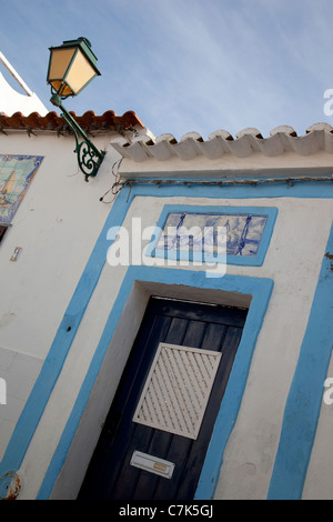 Portugal, Algarve, Ferragudo, Colourful Doorway & Lantern - Stock Image