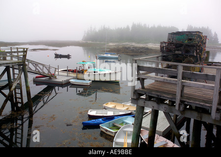 Boats in Maine harbor on foggy day - Stock Image