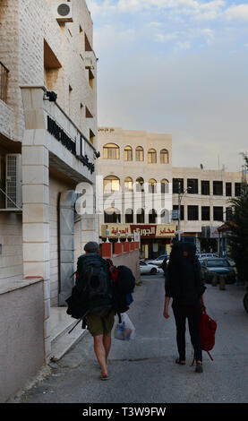 Backpackers in Madaba, Jordan. - Stock Image