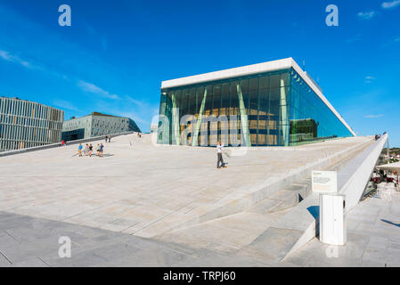 Oslo Opera House, view in summer of a tourist taking a photo while standing on the access ramp leading to the roof of the Oslo Opera House, Norway. - Stock Image