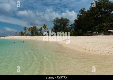 People sunbathing on Koh Lipe beautiful white sand beach, Thailand - Stock Image