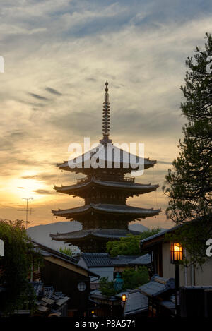 Composite photo of Hokanji Temple Pagoda with beautiful sunset yellow sky in the background, in Kyoto, Japan. - Stock Image