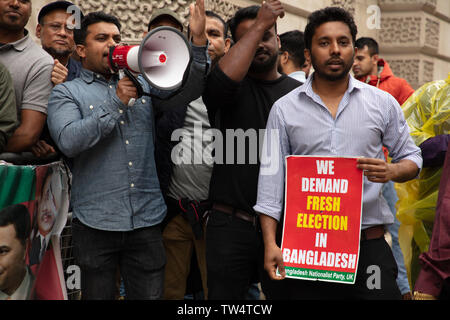 London, UK. 18th June 2019. Loud protest by the London Bangladeshi community, the Bangladesh Nationalist Party (BNP) in front of the Foreign Office, London, asking for the release from prison of Begum Khaleda Zia, the previous Prime Minister of the country and for fresh new independent elections. It's striking that Bangladesh has a long tradition of women Prime Ministers from the main political parties. Credit: Joe Kuis / Alamy - Stock Image