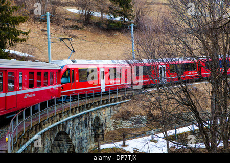 Bernina Express, traveling from Lugano to St. Moritz, near Bernina Pass, Switzerland, Europe - Stock Image
