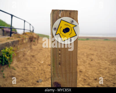 Waymark England Coast Path National Trail pointing North in Marke by the Sea North Yorkshire - Stock Image