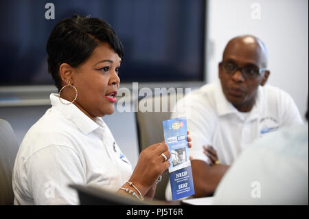 180827-N-PO203-0014 ATLANTA, Ga. (Aug. 27, 2018) Dr. Sophoria Westmoreland, from the Office of Naval Research (ONR), and Anthony C. Smith, program director for the Department of Navy (DoN) Historically Black Colleges and Universities/Minority Institutions (HBCU/MI) Program, visit with faculty and staff at Georgia State University to discuss internships, grants, and other opportunities  available for students and faculty at Navy labs. (U.S. Navy photo by John F. Williams/Released) - Stock Image