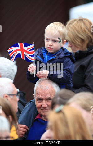 People wait for the arrival of the Duke and Duchess of Cambridge ahead of their visit to Keswick town centre as part of a visit to Cumbria. - Stock Image