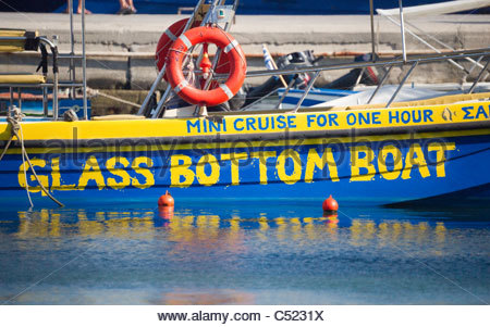 Glass bottom boat for tourist sightseeing trips Greece - Stock Image
