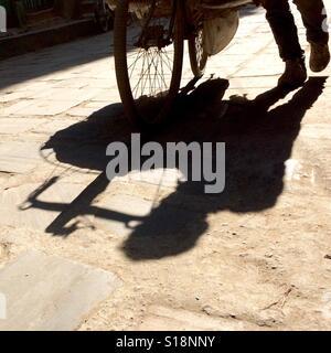Shadow of vegetable seller, Kathmandu, 2017 - Stock Image