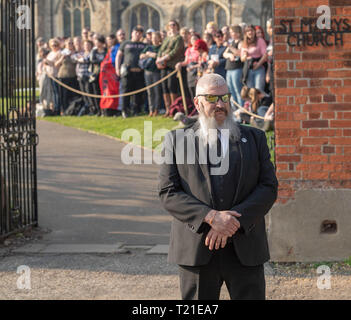 Braintree, Essex, UK. 29th Mar 2019.  Funeral of Prodigy frontman Keith Flint at St Mary's Church in Bocking attended by hundreds of his fans amid tight security Credit: Ian Davidson/Alamy Live News - Stock Image