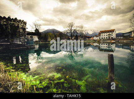 blue mountain lake with reflection in Puchberg am Schneeberg in lower Austria with reflection in the water - Stock Image