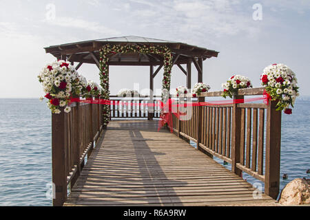 The Flowered Pavilion On Lake Garda Is Waiting For The Bride And Groom - Stock Image