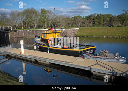 Small open deck boat Grimsby Isle CY 64 in the Caledonian Canal between Inverness and Fort William, Highland Region - Stock Image