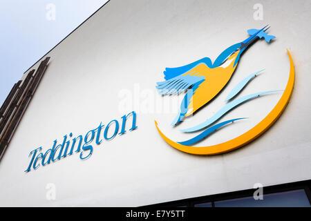 Teddington school logo on building exterior. - Stock Image